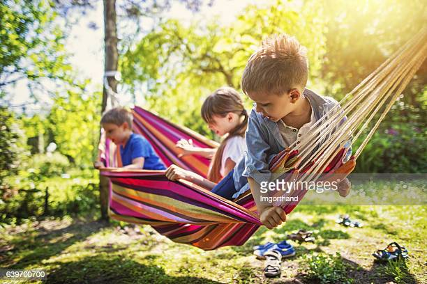 Kids playing on hammock in the garden