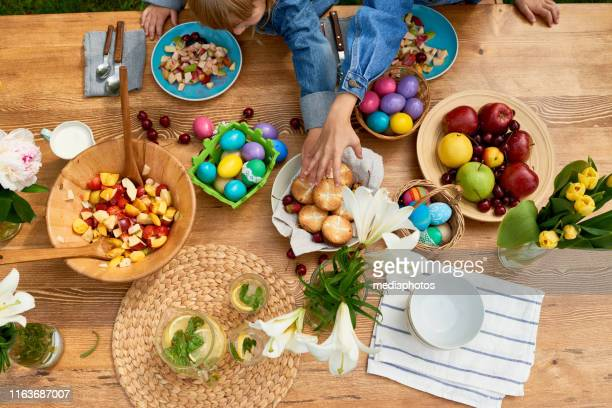 kids playing over festive table - easter dinner stock pictures, royalty-free photos & images
