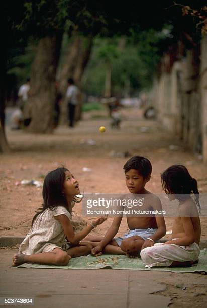 Kids Playing Pick-up Sticks