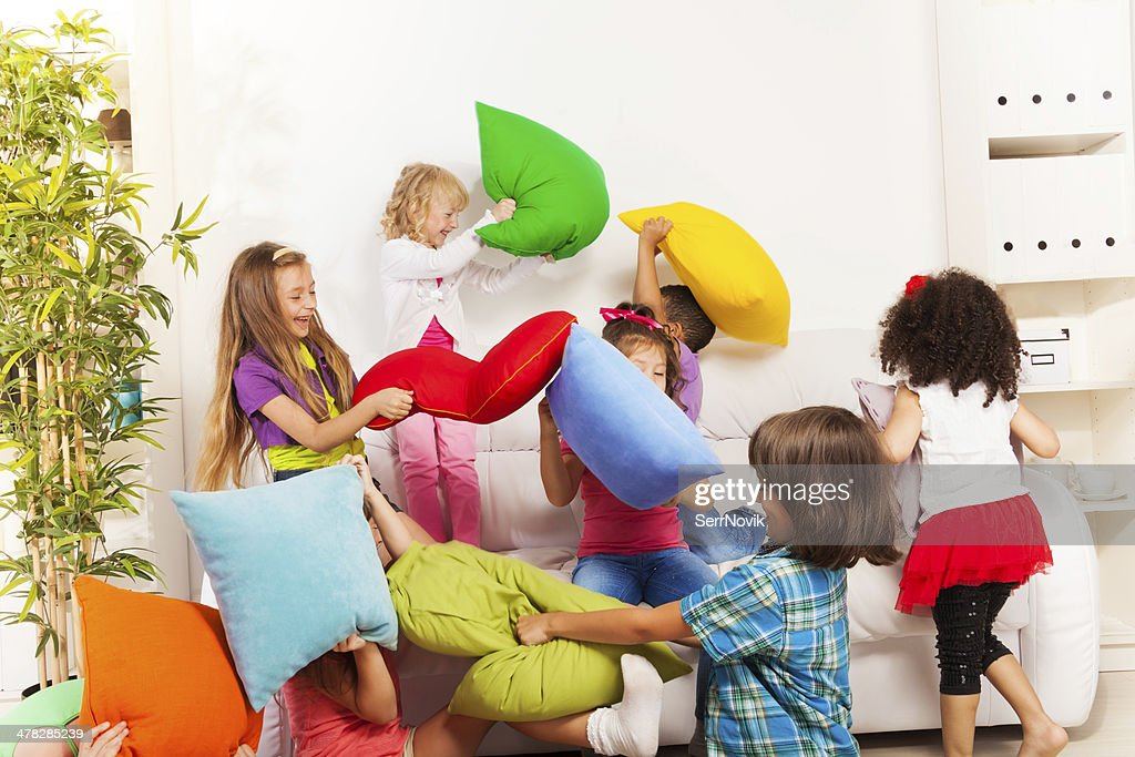 Kids playing pillow fight : Stock Photo