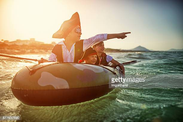 kids playing pirates at sea on a boat - female pirate stock photos and pictures