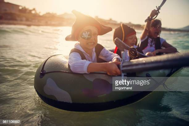 Kids playing pirates at sea on a boat