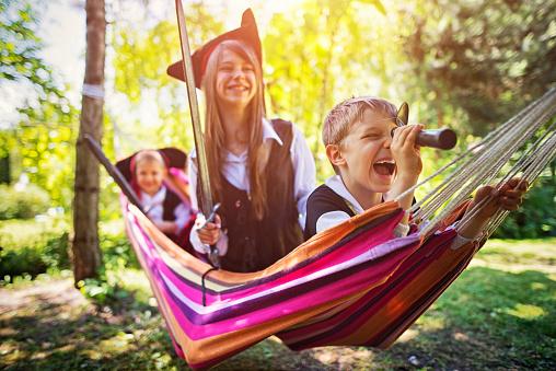 Kids playing pirates on hammock boat - gettyimageskorea
