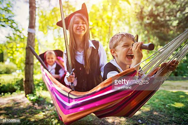 kids playing pirates on hammock boat - period costume stock pictures, royalty-free photos & images