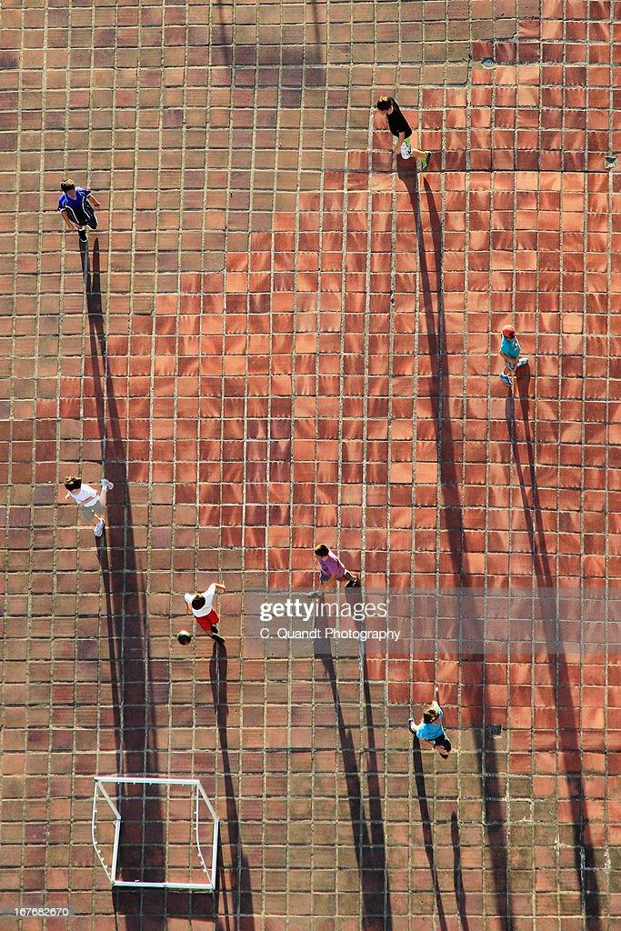 Kids playing soccer : Stock Photo