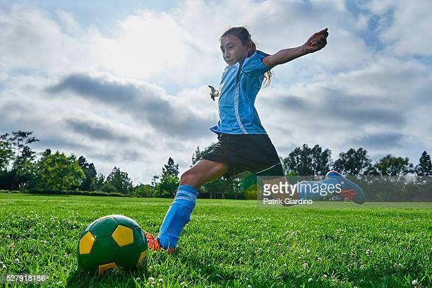 kids playing soccer - scoring a goal stock pictures, royalty-free photos & images