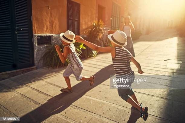 Kids playing tag in mediterranean street