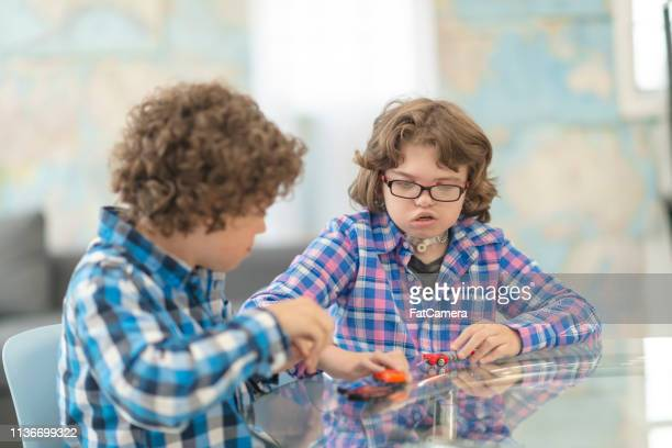 kids playing together - assistive technology stock pictures, royalty-free photos & images