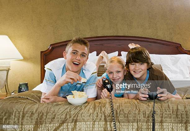 Kids playing video games in hotel room