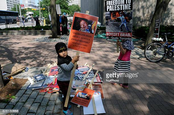 Kids playing with banners and placards during the International Al-Quds day rally on July 11, 2015 in Toronto, Canada.