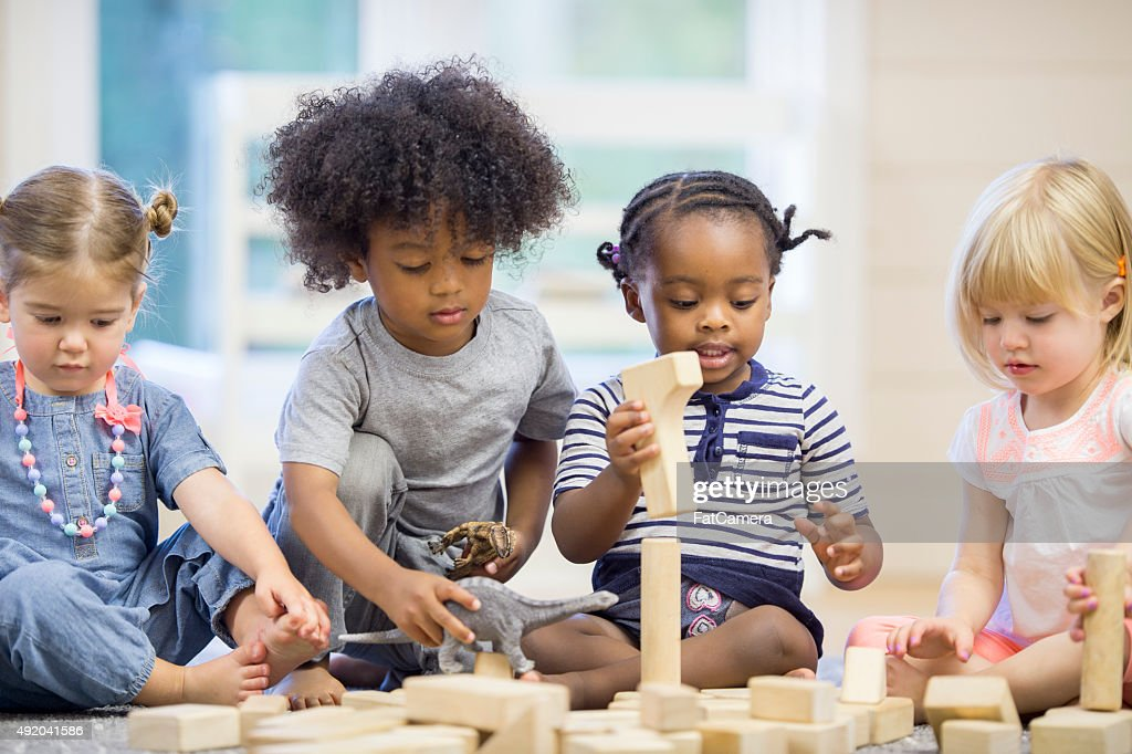 Kids Playing with Building Blocks : Stock Photo