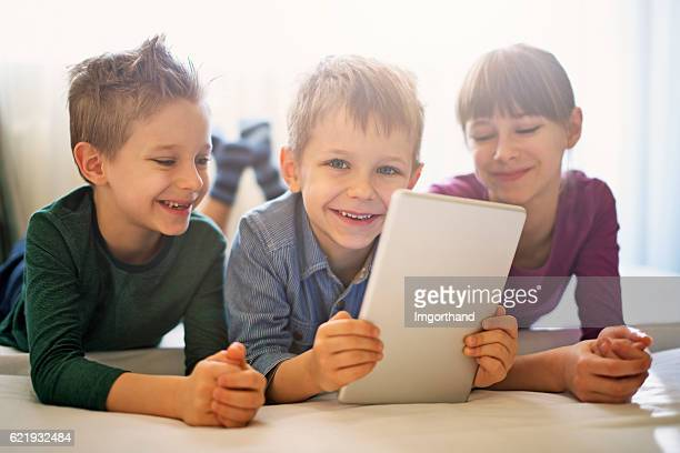 Kids playing with digital tablet