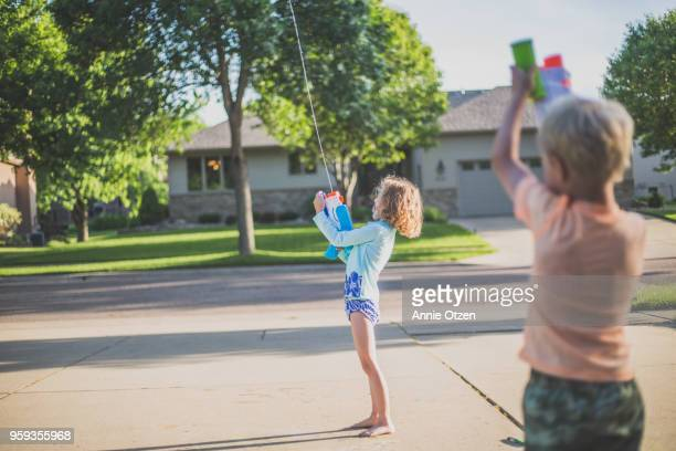 Kids Playing with squirt guns