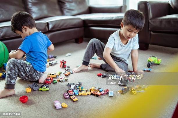 kids playing with toys in living room.