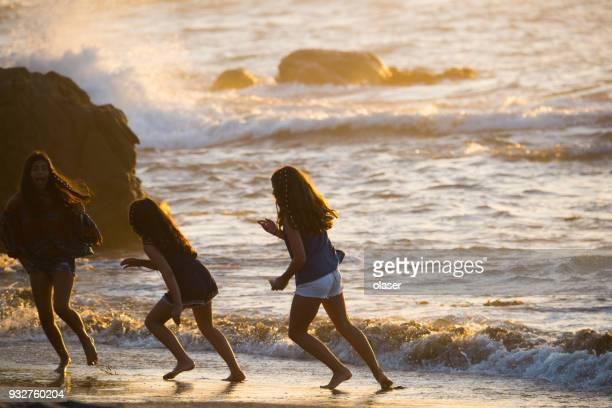 kids playing with waves. - vina del mar stock pictures, royalty-free photos & images