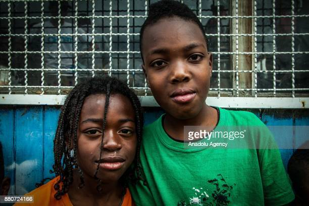 Kids pose for a photo at a provisional school in Bogota, Colombia on November 27, 2017. Colombia has one of the largest population of internally...