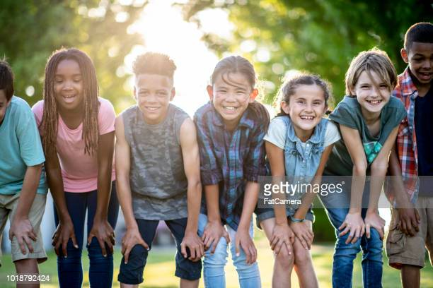 kids posing outside - playing stock pictures, royalty-free photos & images