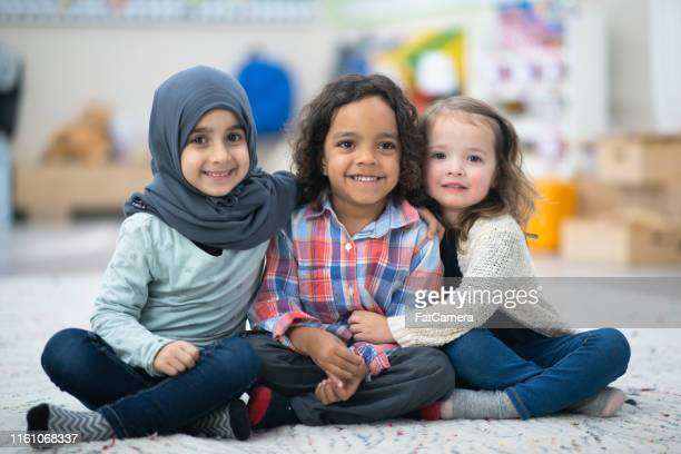 kids posing together - refugee stock pictures, royalty-free photos & images