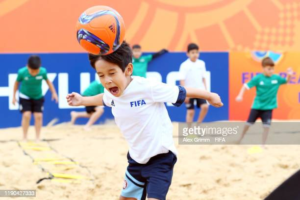 Kids practice Beach Soccer at the Grassroots Festival FIFA Beach Soccer World Cup Paraguay 2019 on November 27, 2019 in Asuncion, Paraguay.