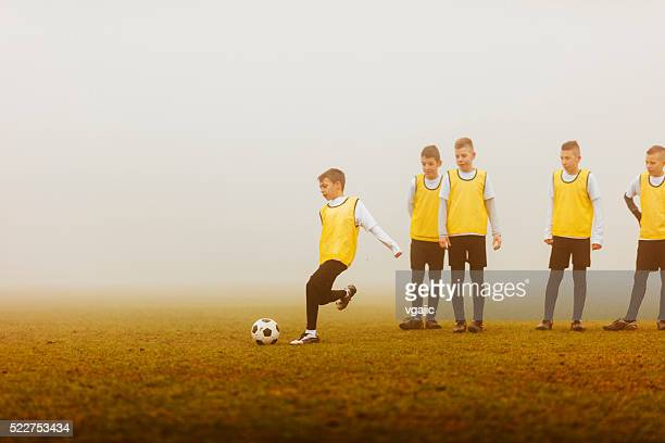 Kids Practicing Strategy At Soccer Training