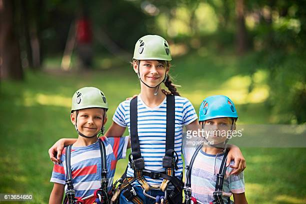 Kids preparing to have fun in ropes course adventure park