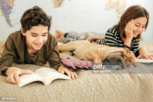 Kids reading and dog snoring