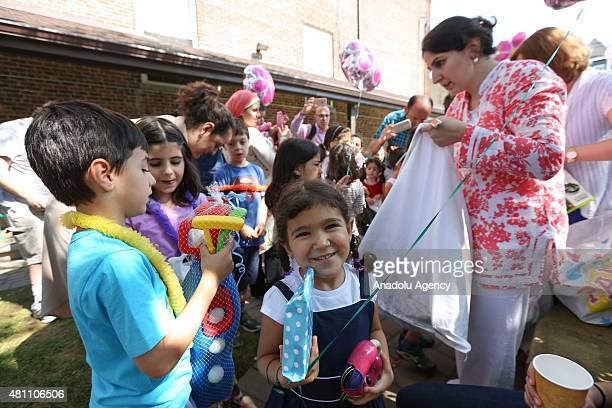 Kids receive gifts in the courtyard of the Bergen Religious Mosque and Cultural Center in Cliffside Park New Jersey on July 17 on the first day of...