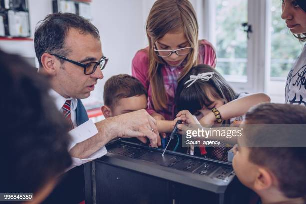kids repairing computer - child prodigy stock pictures, royalty-free photos & images