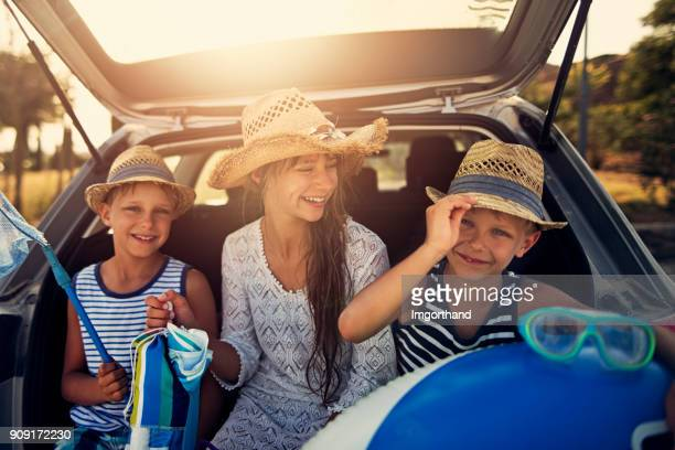 Kids returning from beach by car
