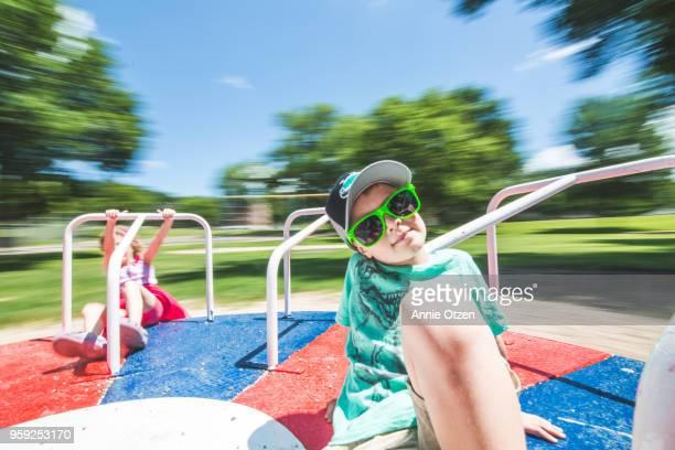 Kids riding a merry go round