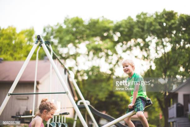 Kids Riding a small teeter totter