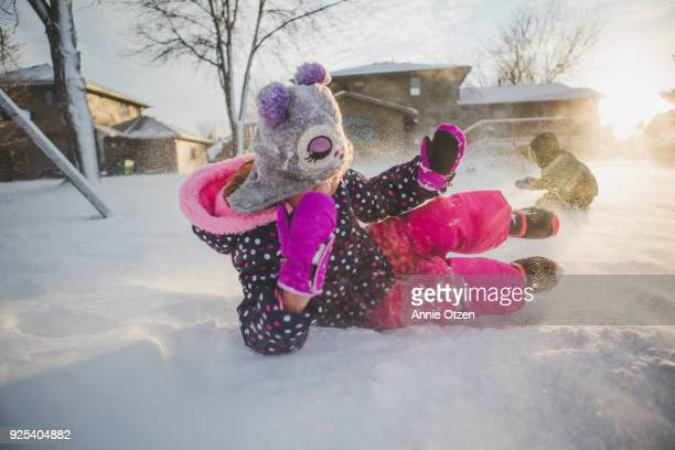 Kids Rolling around in Snow