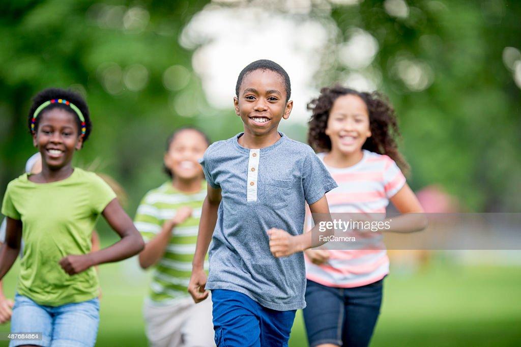 Kids Runnign Around at the Park : Stock Photo