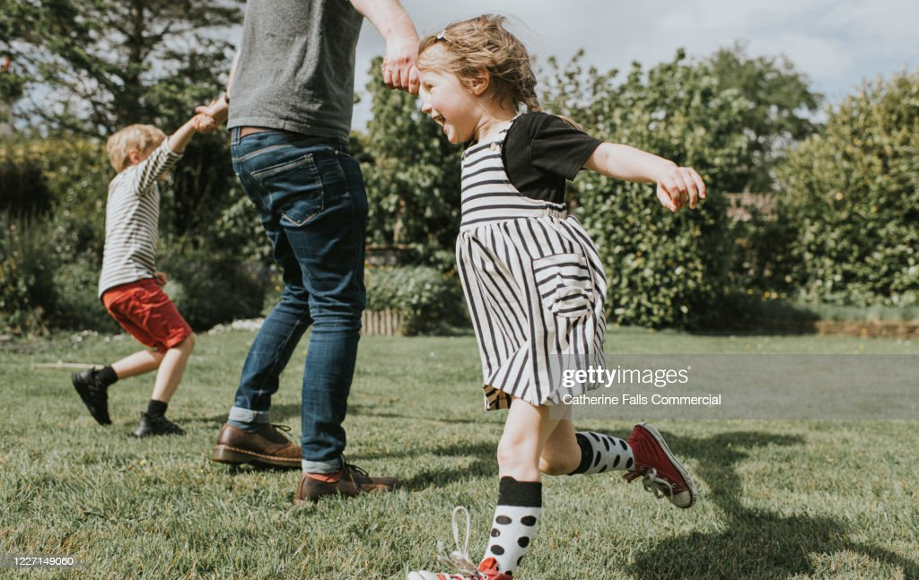 Kids running in a Garden : Stock Photo