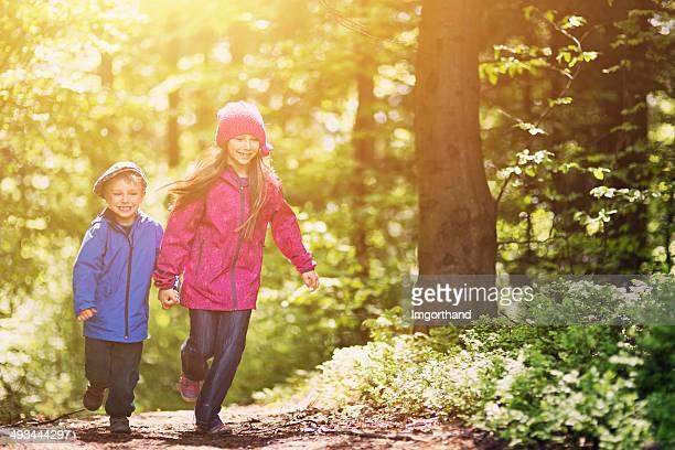 Kids running in forest