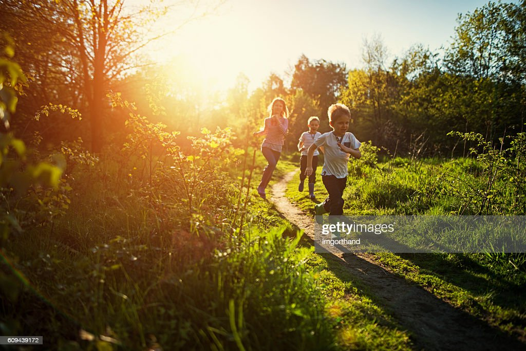 Kids running in nature. : Stock Photo