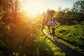 Kids running in nature.