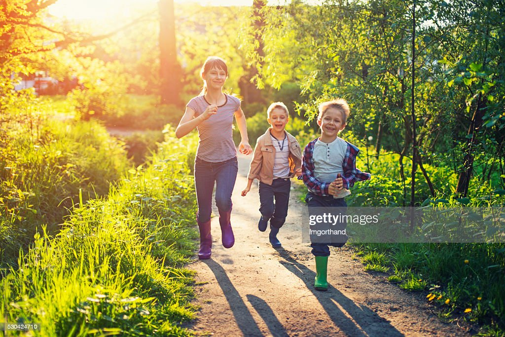 Kids running on a forest path. : Stock Photo