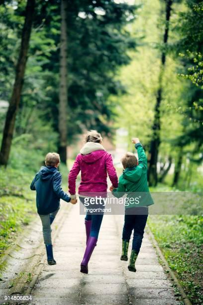 Kids running on city park path