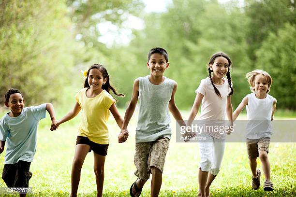 kids running - kids playing tag stock photos and pictures