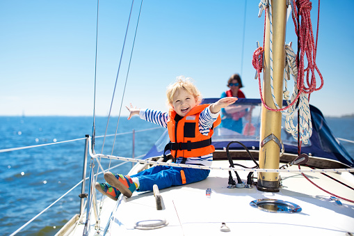 Kids sail on yacht in sea. Child sailing on boat. 962347962