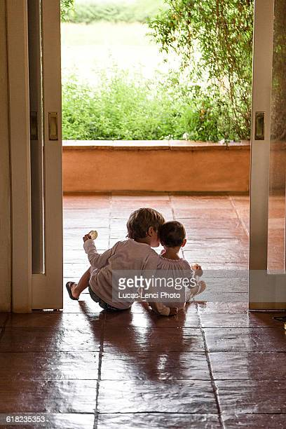 kids seated by footstep
