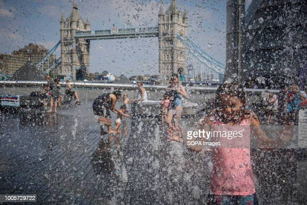 Kids seen playing at a water fountain and cooling down on a hot day High temperatures in the United Kingdom will continue and the temperatures will...