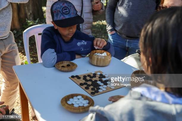 Kids seen playing the game of Go during the Japan Fest 2019 in Montevideo. Every year, the Japanese Embassy in Uruguay organizes the Japan festival...