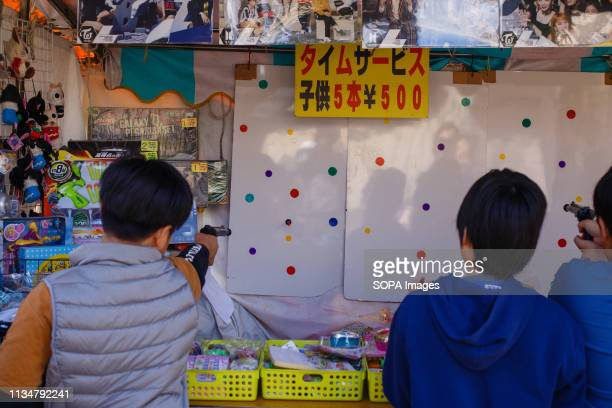 Kids seen plying at a game stall during the Iwakura Cherry Blossom Festival The highlight of the festival is long line of trees created by around...
