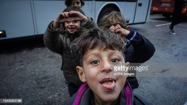 Kids seen smiling to the camera during their arrival at the port 400 migrants and refugees were transferred upon their arrival from the island of...