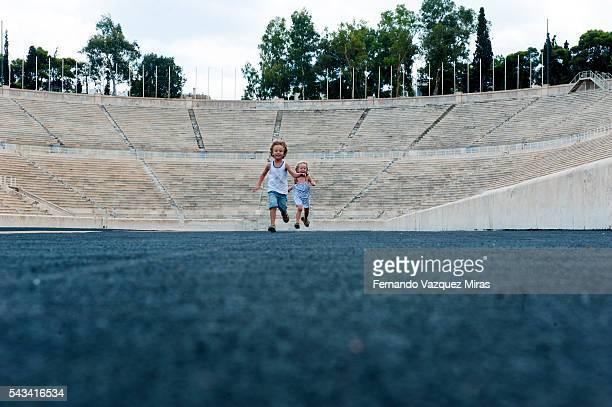 Kids simulating a big run at the Panathenaic Stadium, Athens