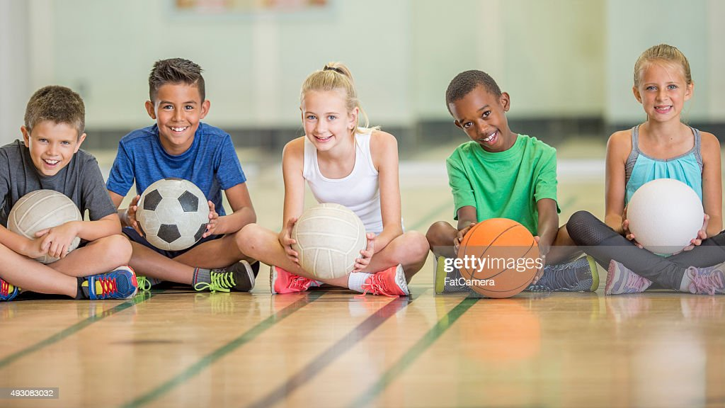 Kids Sitting at the Gym : Stock Photo