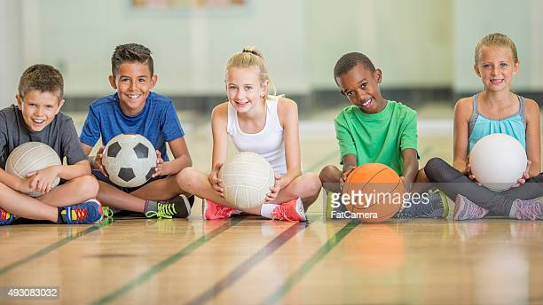 kids sitting at the gym - sports ball stock pictures, royalty-free photos & images