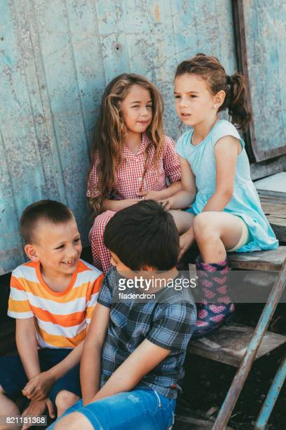 Kids sitting on stairs outdoors